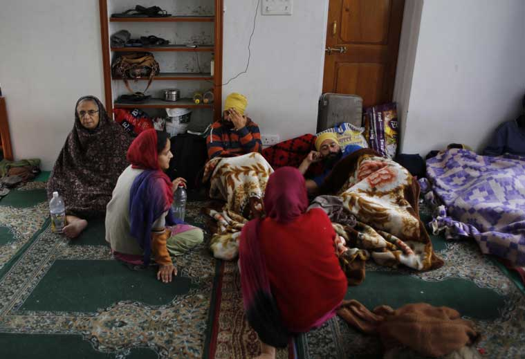 A Kashmiri Sikh family takes shelter at a makeshift relief camp set up at a mosque in Srinagar, Indian-controlled Kashmir, Thursday, Sept. 11, 2014. (Source: AP photo)