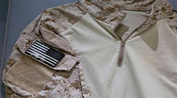 In this Sept. 5, 2014 photo provided by the National September 11 Memorial and Museum, the fatigue shirt worn by the U.S. Navy SEAL during the mission to capture Osama bin Laden, is seen in a case at the museum in New York. ( Source: AP )