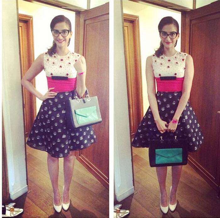 The actress look chic in a short dress with cat-eyed specs.