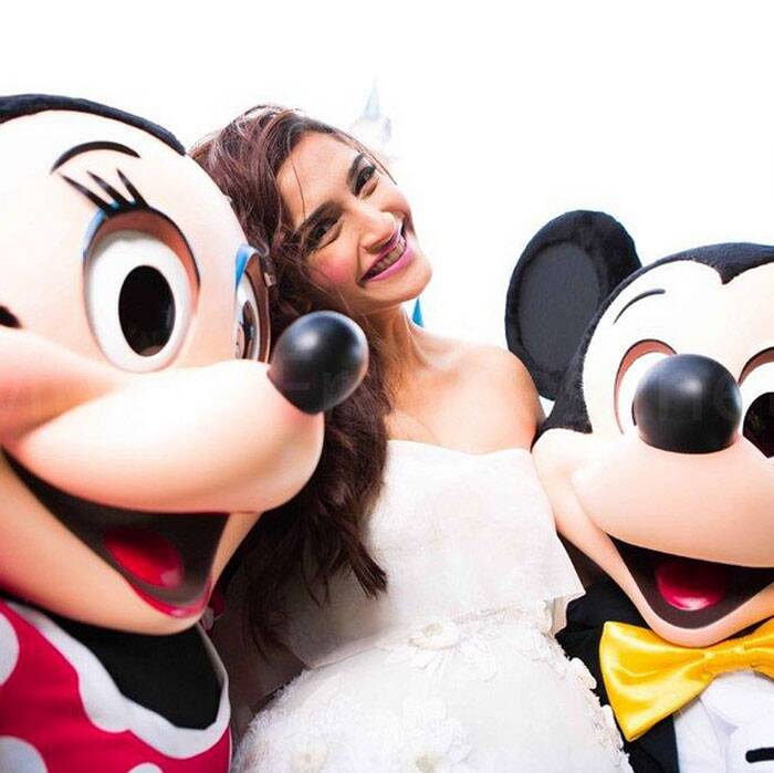 Sonam with Mickey and Mini at Disneyland.