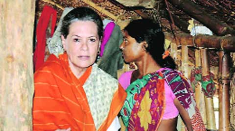 Congress president Sonia Gandhi inside the hut of a villager, in Rae Bareli on Monday. ( Source: PTI )