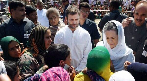 Congress president Sonia Gandhi along with party Vice President Rahul Gandhi meeting with flood affected people at Dehruna village of Anantnag district of South Kashmir on Monday. (Source:PTI)