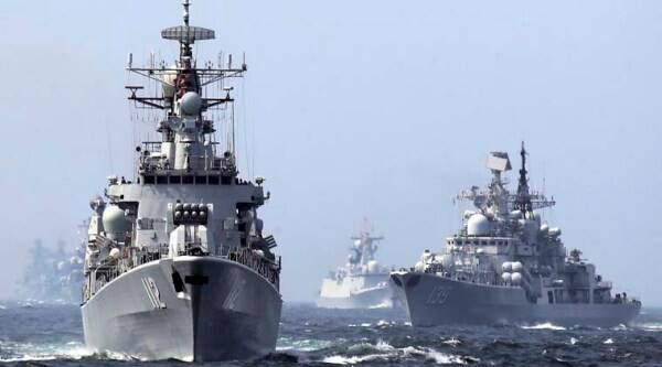 "In this May 24, 2014 photo, China's Harbin (112) guided missile destroyer, left, and DDG-139 Ningbo Sovremenny class Type-956EM destroyer, right, take part in a week-long China-Russia ""Joint Sea-2014"" navy exercise at the East China Sea off Shanghai, China. (Source: AP)"