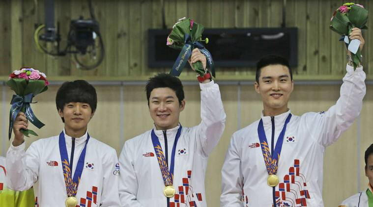 Kim Cheong-yong (L) is exempted from South Korea's mandatory military service for winning an Asian Games gold. Cheong-yong, Jin Jong-oh (C) and Lee Daem-yung (R) won the men's 10m Air Pistol Team event. ( Source: AP)