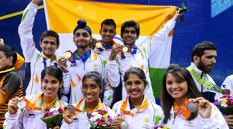 Gold medal winners Saurav Ghosal, Harinder Pal Singh Sandhu, Kush Kuamr and Mahesh Manaonkar Mahesh; and silver medallists Anaka Alankamony, Joshna Chinappa, Aparajitha Balamurukan and Deepika Pallikal pose after the medal ceremony of squash team events. (Source: PTI)