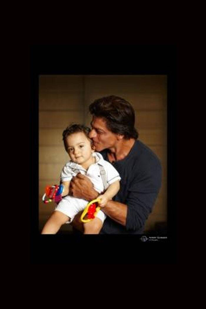"Bollywood superstar Shah Rukh Khan kept his promise made to fans a few days ago and introduced his youngest son AbRam to the world on the auspicious day of Eid al Adha. <br /> SRK, who has shielded his little son from the media for almost a year now, tweeted the first picture of him along with a sweet message, ""Eid Al Adha Mubarak to everyone. May all have the happiness that life has to offer.The littlest one wishes you too."""