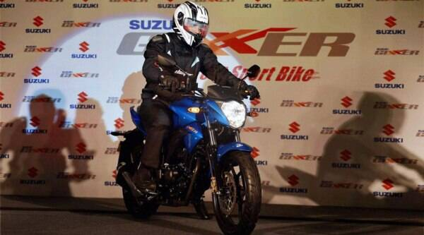 "A model at the launch of ""Suzuki GIXXER"" motorcycle in New Delhi on Tuesday. (Source: PTI)"