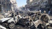 Syrian air raids kill 11 in extremist-held town