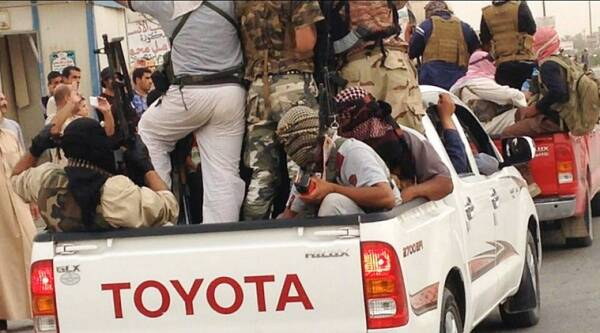 FILE - In this Tuesday, July 29, 2014 file photo, Islamic militants parade in Beiji, some 250 kilometers (155 miles) north of the capital, Baghdad, Iraq. (Source: AP)