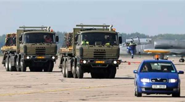 Trucks carry ammunition that the Czech Military is giving to Kurdish Regional Government in Iraq in Pardubice, Czech Republic, Thursday, Sept. 18, 2014. (Source: AP)
