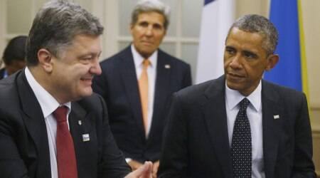 U.S. President Barack Obama is seated with Ukraine President Petro Poroshenko as they meet with other countries regarding Ukraine at the NATO summit at Celtic Manor in Newport, Wales, Thursday, Sept. 4, 2014. (Source: AP)