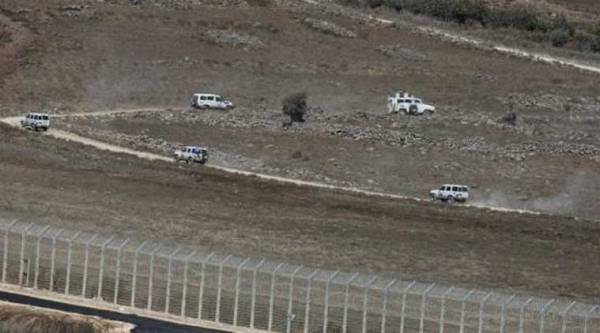 U.N. vehicles drive in Syria near the border fence with the Israeli-occupied Golan Heights September 2, 2014. (Source: Reuters)
