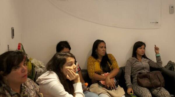 In this Sept, 4, 2014 photo, breast implant patients sit in a waiting room at the metropolitan outpatient surgery center in Caracas, Venezuela. (Source: AP)