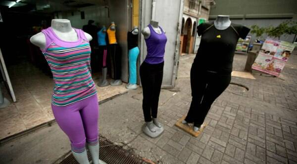 Mannequins stand at a store that sells clothing for over weight people in downtown Caracas, Venezuela, Tuesday, Aug. 26, 2014. (Source: AP)