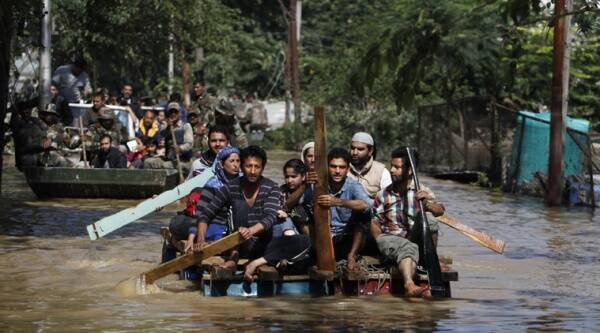 Kashmiri residents use makeshift rafts to rescue flood affected people in Srinagar,
