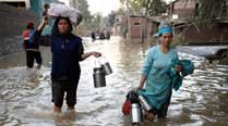 Flood victims run from pillar to post to get relief material
