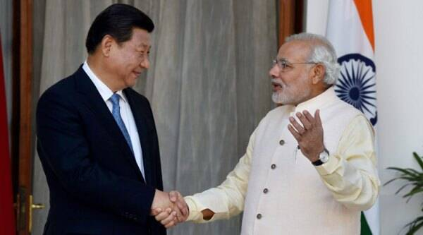 Prime Minister Narendra Modi and Chinese President Xi Jinping shake hands during a meeting at Hyderabad House in New Delhi on Thursday.