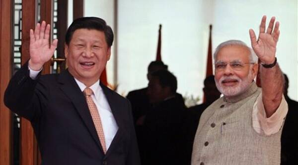Indian Prime Minister Narendra Modi, right, and Chinese President Xi Jinping wave to the media as Modi welcomes Xi upon his arrival at a hotel in Ahmadabad, India. Source: AP photo