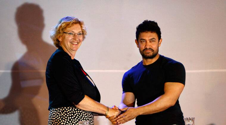 Aamir Khan and UNICEF Regional Director for South Asia Karin Hulshof pose for photographers after UNICEF appointed him as regional Goodwill Ambassador for nutrition, in Katmandu, Nepal, Thursday, Oct. 9, 2014. (Source: AP)