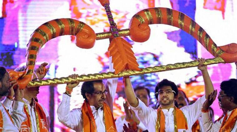 Shiv Sena president Uddhav Thackeray and Yuva Sena leader Aditya Thackeray during a rally in Mumbai on Saturday. (Source: PTI)