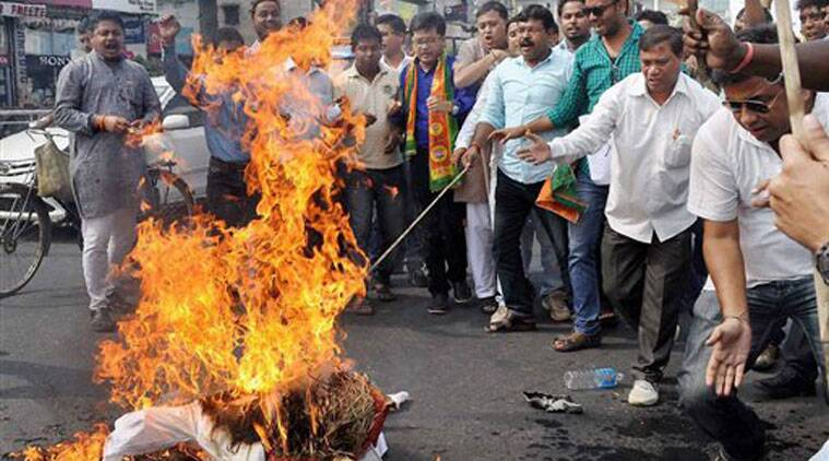 Members of Bharatiya Janata Party (BJP) burn the effigy of AIUDF chief Badaruddin Ajmal at a protest after Special Intelligence Bureau (SIB) reports of his association with Islamic fundamentalists of Bangladesh in Guwahati on Wednesday. (Source: PTI)
