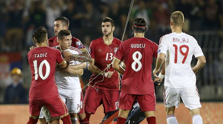 As tensions rise on and off the pitch, players lose their cool and scuffle as the Albanians try to  retrive the flag
