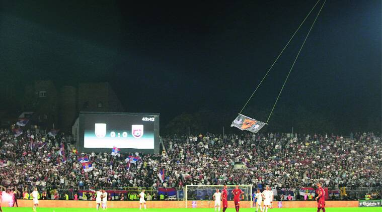 A drone carries the  'Greater Albania' flag over the Partizan Stadium in Belgrade during Albania-Serbia Euro qualifier