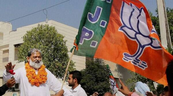 BJP candidate Anil Vij takes out a victory procession after his win in Assembly polls in Ambala on Sunday.(Source: PTI Photo)