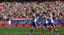 Atletico de Madrid win as Carlos Bacca and Kevin Gameiro put Sevilla on second