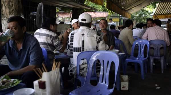 Vietnamese men drink beer at an outdoor beer parlor in Hanoi, Vietnam on Wednesday Oct. 8, 2014. (Source: AP)