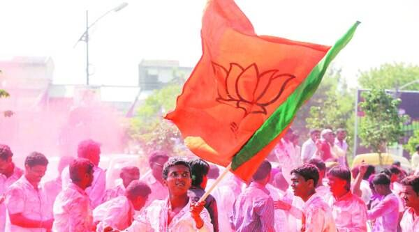 BJP supporters celebrate the party's unprecedented victory in Pune city, at Chhatrapati Shivaji Sports Complex, Balewadi, where the votes were counted Sunday. (Source: Express photo by pavan Khengre)