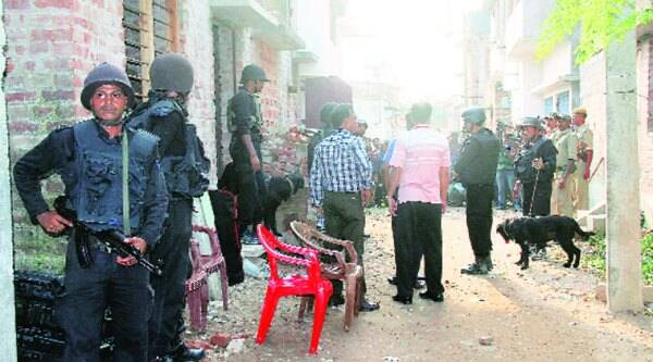 NSG commandos during a search operation at the home of one of the accused, Rezaul Karim, where they reportedly recovered 35 live bombs; Hara Sheikh, Khairul Sheikh and Azaur Sheikh, construction workers in Kerala, had come home to Simulia for Eid but can't leave for work because of the probe into the blast.