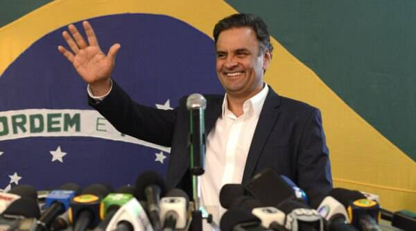 Aecio Neves, presidential candidate of the Brazilian Social Democracy Party, PSDB, waves during a press conference in Belo Horizonte, Brazil, Sunday, Oct. 5, 2014.(Source: AP)