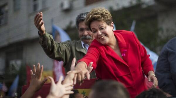 Brazil's President Dilma Rousseff, presidential candidate for re-election of the Workers Party, PT, greets supporters during a campaign rally in Porto Alegre, Brazil, Saturday, Oct. 4, 2014. (Source: AP)