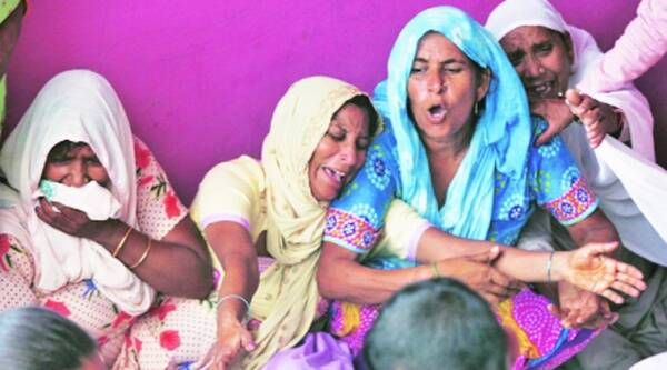 Family of a victim at Arnia village near Jammu Monday. Source: Reuters