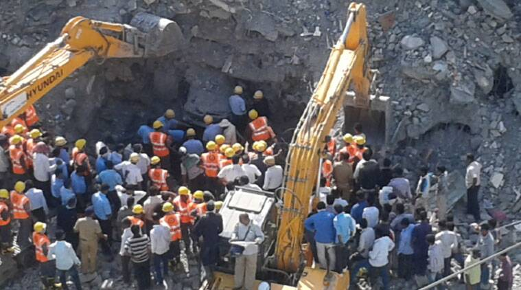 The rescue work going on at the building collapse site. The NDRF and Fire Brigade officials are yet to locate Sandip Mohite (29) who's trapped under the debris. (Express Photo by Arul Horizon).