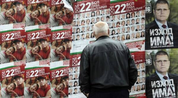 A man looks at pre-election posters of the Bulgarian Socialist's party in Sofia, Friday, Oct. 3, 2014. (Source: AP)