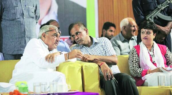Congress candidate from Panchkula D K Bansal interacts with Haryana CM Bhupinder Hooda during an election rally in Panchkula on Wednesday. (Express photo by Jaipal Singh)