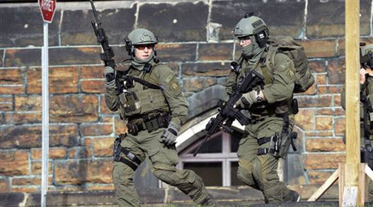 A Royal Canadian Mounted Police intervention team responds to a reported shooting at Parliament building in Ottawa Wednesday Oct. 22, 2014. (Source: AP)