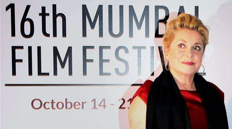 French actress Catherine Deneuve poses for photos at the opening ceremony of the16th Mumbai Film Festival in Mumbai. (Source: AP photo)