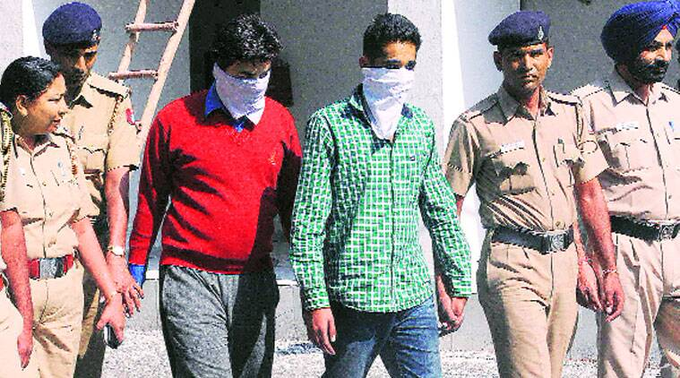 The accused in police custody in Chandigarh on Monday. (Source: Express photo)