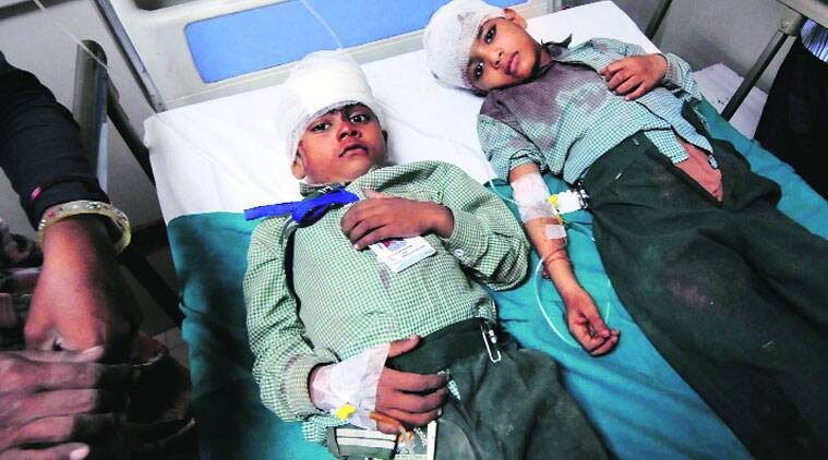 Two of the 24 children who were injured. (Source: Express photo by Gajendra Yadav)