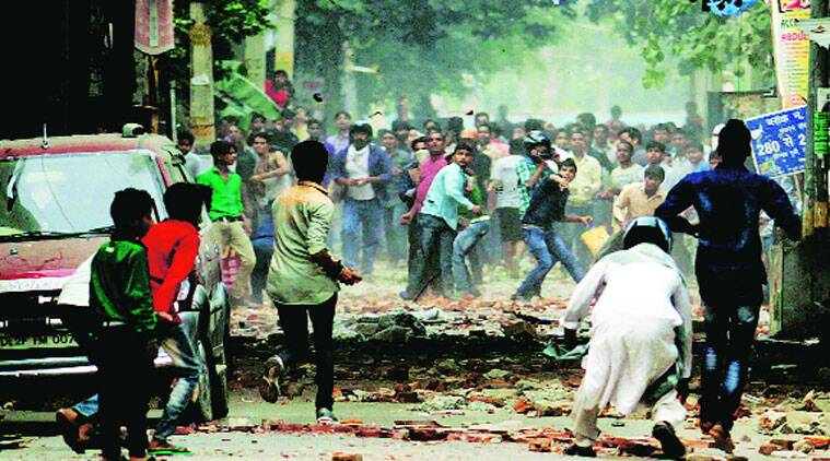 Hindus, Muslims clash in Trilokpuri on Saturday. Forces struggled to contain the violence that began Friday. (Source: Praveen Khanna)