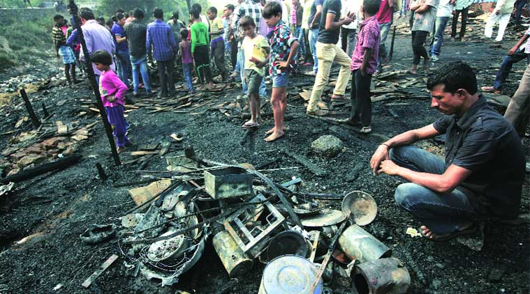 55 jhuggis were destroyed in Shastri Park. (Source: Express photo by Amit Mehra)