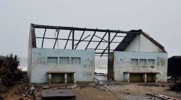 A view of a damaged house due to cyclone Hudhud at Konapapapeta village beach in East Godavari District of Andhra Pradesh on Sunday. (Source: PTI Photo)
