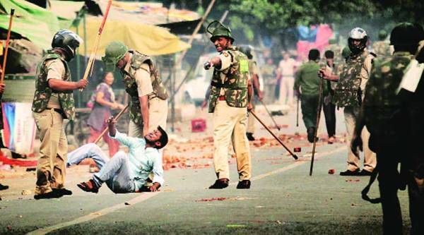 Clashes between Hindus and Muslims in Trilokpuri escalated on Saturday. (Express photo by Praveen Khanna)