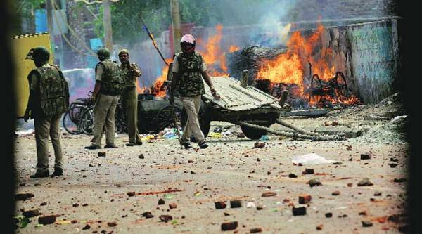 Police had to resort to lathicharge and firing tear gas shells to disperse the rioters in Trilokpuri. (Express photo by Praveen Khanna)