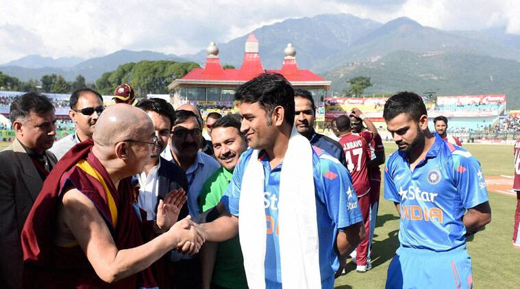 MS Dhoni with Virat Kohli, shakes hand with spiritual leader Dalai Lama before the start of the 4th One Day International match between India and West Indies (Source: PTI)