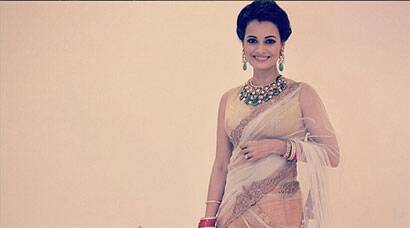 Dia Mirza dazzles in gold at her wedding reception