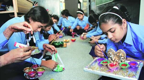 Students work on diyas at the Bhartiya Vidya Mandir in Ludhiana on Thursday. (Gurmeet Singh)